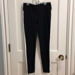 black leggings with white stripe down the side